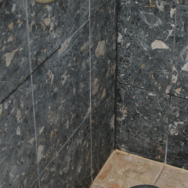 Damaged tiles, damaged stone, damaged shower, shower restoration